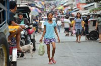 A busy street shot from Bagong Silang, formerly the most infamous and dangerous slum in the Philippines. More than one million people live within a 600 hectare area (which is the size of the Sydney CBD). In a decade, the work of GK has transformed it into one of Manila's more peaceful areas. (IMAGE: CHRIS GRAHAM)