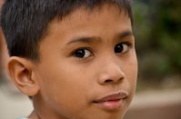 A kid from the former slum of Bagong Silang. (IMAGE: CHRIS GRAHAM)