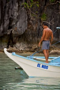 An El Nido boatman, plies his trade at the Big Lagoon, a stunning natural lagoon a short distance from the town.