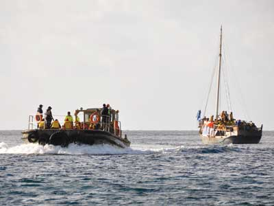 Asylum seekers arrive by boat on Christmas Island, July 8, 2011.