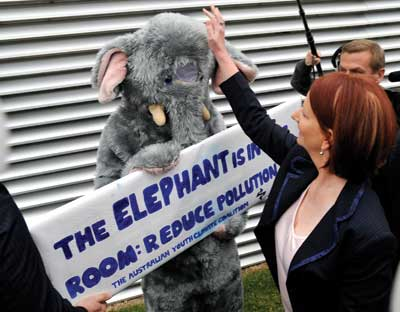 Prime Minister Julia Gillard pats the climate change elephant.