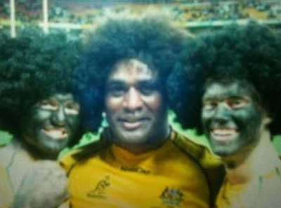 Wallabies star Radike Samo with the two fans in blackface, who attended the game courtesy of Qantas.