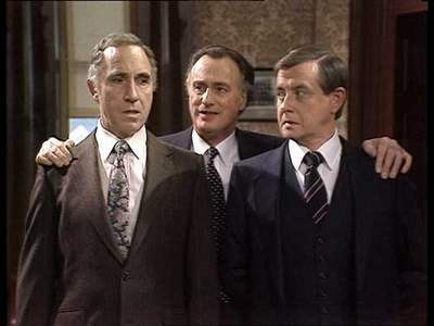 Sir Humphrey Appelby (left) and Bernard Woolley (right) with Jim Hacker from the popular BBC series Yes Prime Minister.