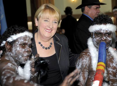 Indigenous affairs minister Jenny Macklin poses with Aboriginal dancers from Arnhem Land Benny (left) and David Wilford in Canberra on April 3, 2009 at the ceremony to endorse the UN Declaration on the Rights of Indigenous Peoples.