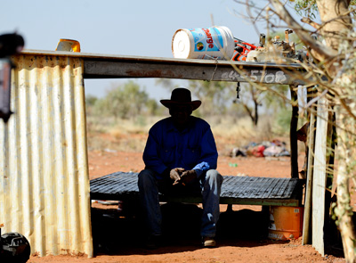 Kingi Ross, from Arlparra on the edge of the vast Utopia region. Humpies - makeshift shelters - are a common sight throughout Aboriginal Australia, courtesy of a lack of basic housing.